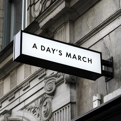 a day's march store sign